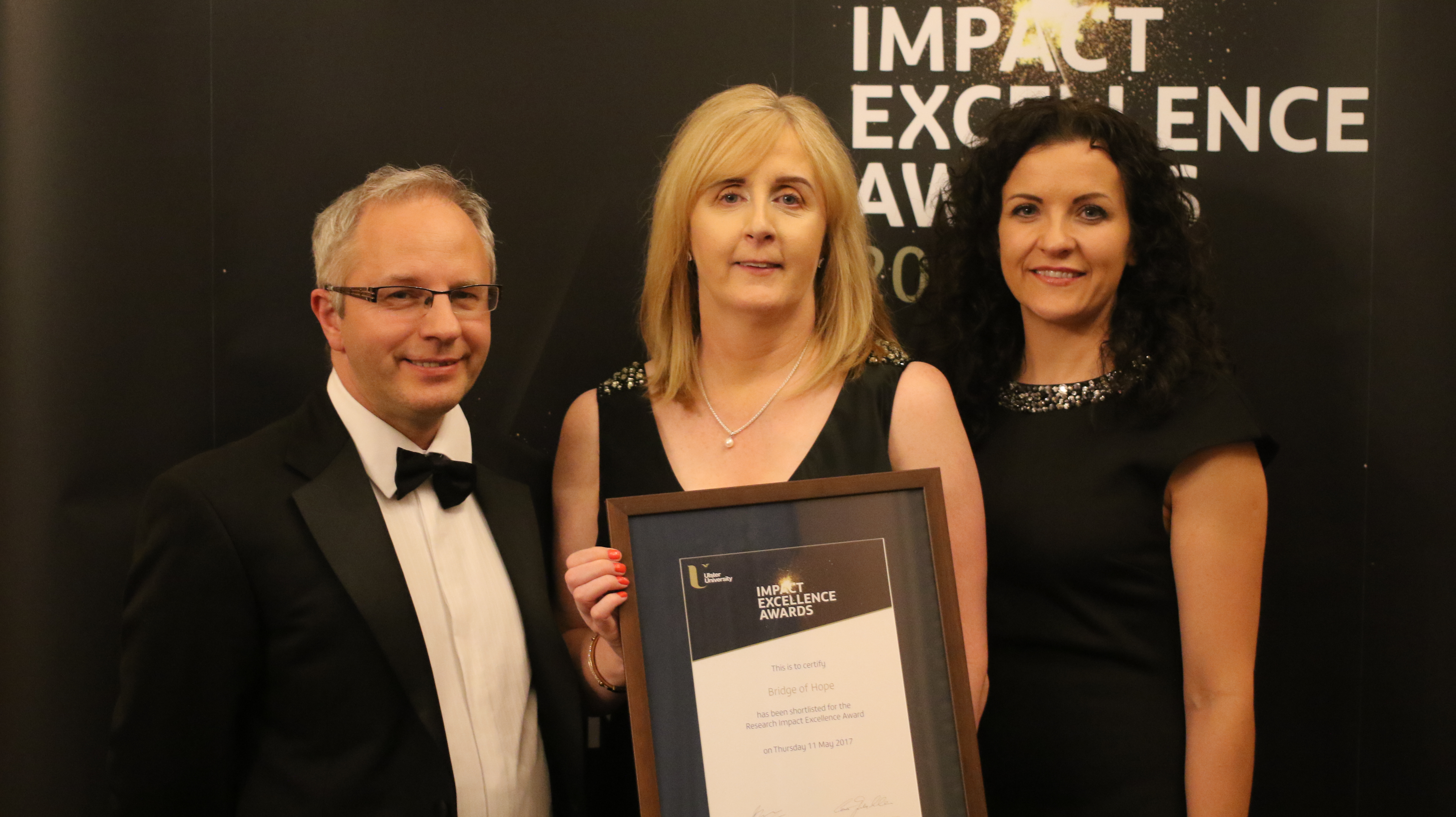 Ulster University Impact Excellence Awards 2017 at Belfast Harbour Commission. TJI Director Rory O'Connell, ACT Head of victims & Mental Health Services Irene Sherry & TJI Research Manager Lisa Thompson. Bridge of Hope was shortlisted for its partnership work with TJI on the Grassroots Toolkit.